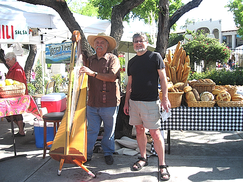 Francisco Gonzales with one his 7 Mexican harps, at the Sunday Farmer's Market